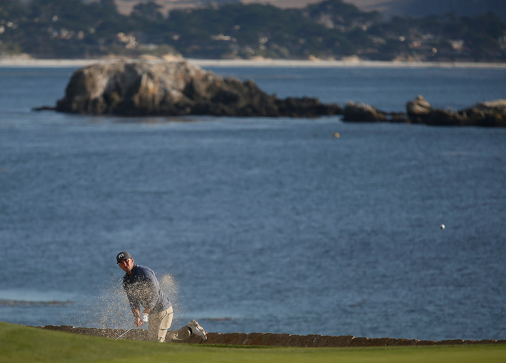 . Max Home hits his ball from a trap on the 18th fairway during the final round of the TaylorMade Pebble Beach Invitational golf tournament at Pebble Beach Golf Links on Sunday November 19, 2017. (David Royal/Herald Correspondent)