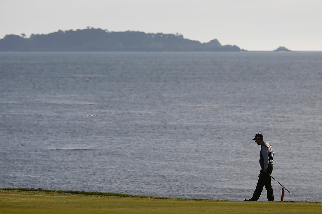 . Kevin Sutherland walks along the edge of the  on the 18th teebox during the final round of the TaylorMade Pebble Beach Invitational golf tournament at Pebble Beach Golf Links on Sunday November 19, 2017. Sutherland finished tied for second at -6 after leading at the beginning of the day. (David Royal/Herald Correspondent)