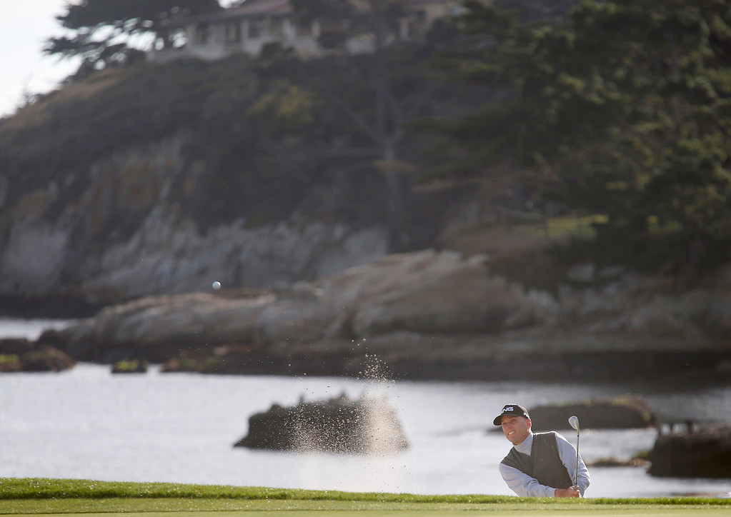. Kevin Sutherland digs himself out of a sand trap on the 18th green during the final round of the TaylorMade Pebble Beach Invitational golf tournament at Pebble Beach Golf Links on Sunday November 19, 2017. Sutherland finished tied for second at -6 after leading at the beginning of the day. (David Royal/Herald Correspondent)