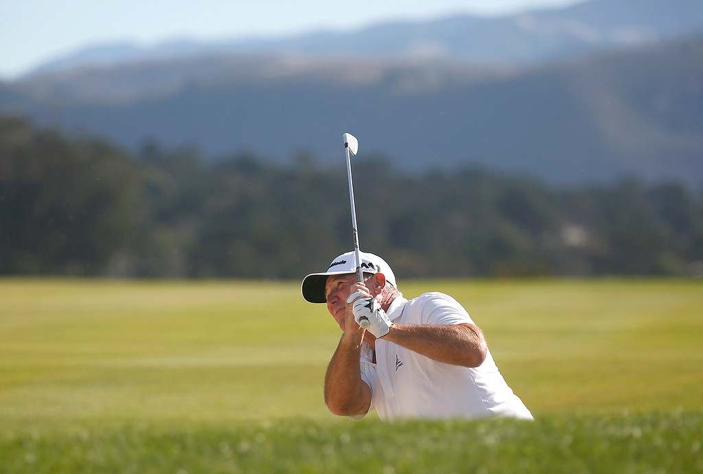 . Duffy Waldorf knocks his ball from a trap on the 14th fairway during the final round of the TaylorMade Pebble Beach Invitational golf tournament at Pebble Beach Golf Links on Sunday November 19, 2017. Waldorf went on to win the tournament at -7. (David Royal/Herald Correspondent)