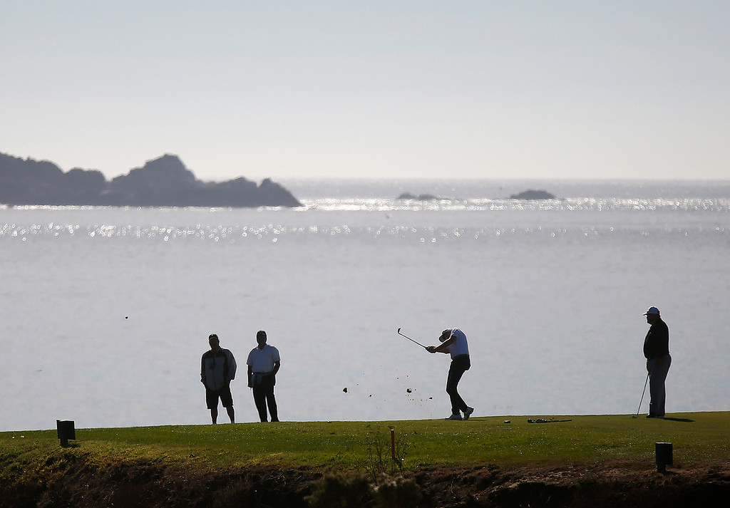 . Players make their way through the 8th green during the final round of the TaylorMade Pebble Beach Invitational golf tournament at Pebble Beach Golf Links on Sunday November 19, 2017. (David Royal/Herald Correspondent)