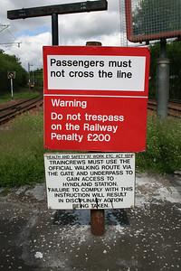 """Hyndland depot  """"Not an Official Walking Route"""" sign"""