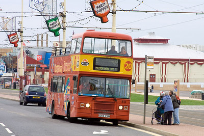 813 is an ex London Transport Olympian seen here on the Open Top Tour move
