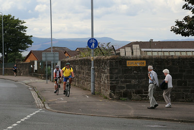 Shared use footway sign in shared use!   Cracking snap.  The beige team survived and were not mown down by the Tour de Clyde team....