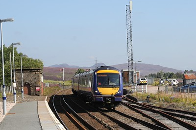 170410 thunders south through Dalwhinnie