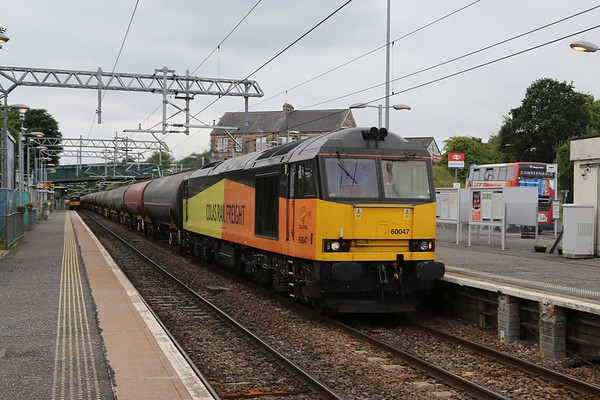 60047 seems undeterred and thunders through Cumbernauld with 6S36 Dalston - Grangemouth empties