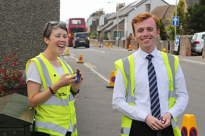 xPlore Dundee staff having a fun time at the Shuttle Bus stop