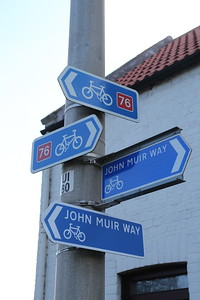 Do we really need two sets of signs?  Surely the 76 could go on the John Muir Way signs