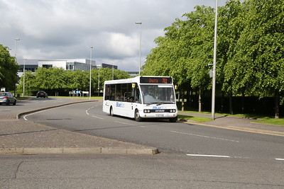 Blue Bus YJ07 EHB heads out of Alba Business Park