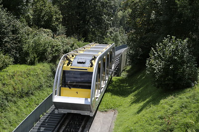 Car 1 departs downhill