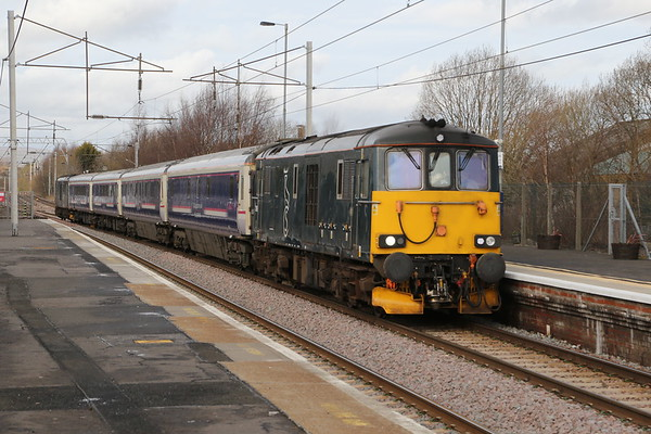 73968 leads 73970 through Coatbridge Central with 5Z25 1002 Clayhills to Polmadie on 16th February 2019