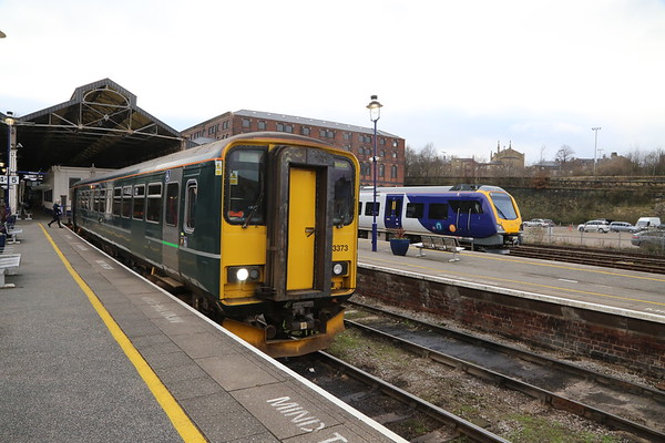 153373 and 195006 at Huddersfield