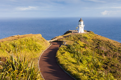 Pathway leading to Cape Reinga lighthouse above Pacific Ocean