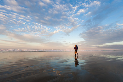 Female tramper (40's) walks Te Araroa Trail at sunrise, Ninety Mile Beach/Te Oneroa-a-Tōhē, Northland