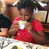 Helene Carter, 10, of Tyngsboro delicately sipped tea at the Billerica Historical Society's event. Photo by Mary Leach