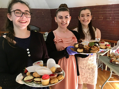 Volunteers Cassie Modoono, Leah Cahill and Chelsey Mathews served tea to guests at the Billerica Historical Society's Vintage Tea. Photo by Mary Leach