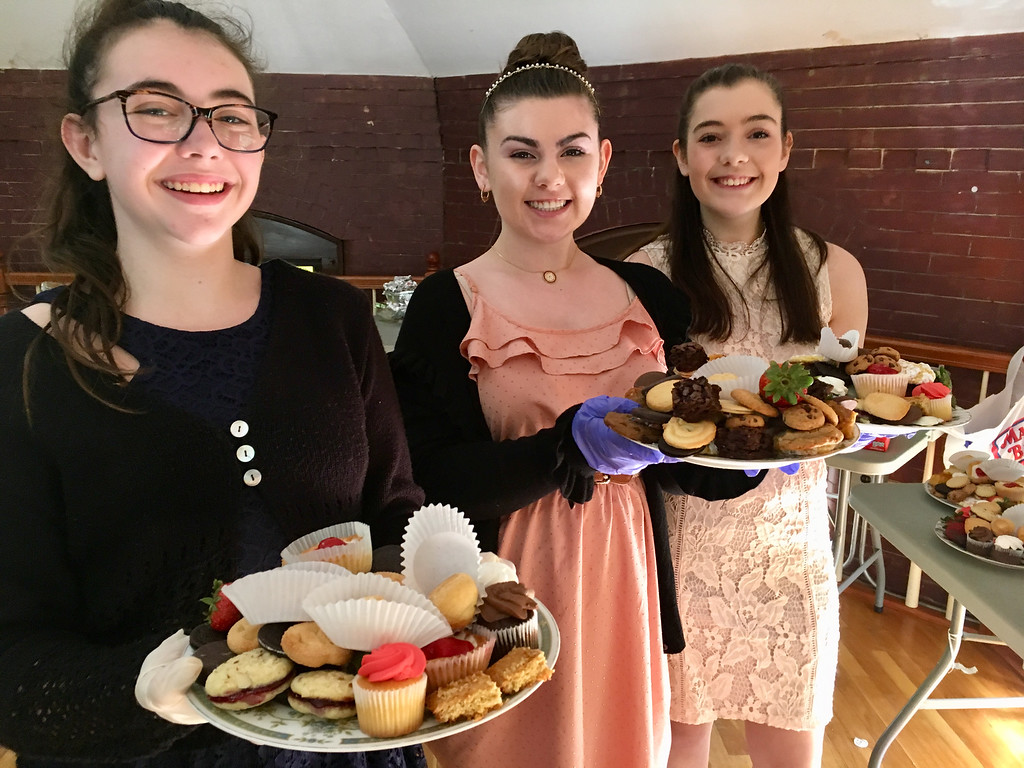 . Volunteers Cassie Modoono, Leah Cahill and Chelsey Mathews served tea to guests at the Billerica Historical Society�s Vintage Tea. Photo by Mary Leach