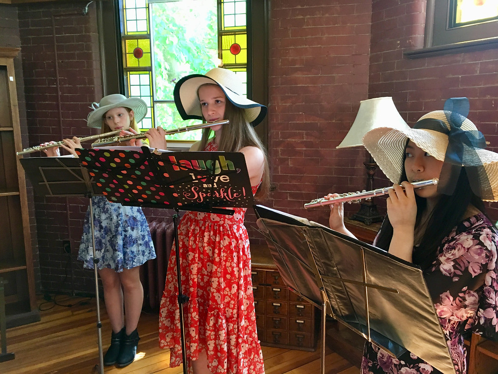 . Caitlin Salter, Kate Bowen and Karina Yee entertained guests at the tea. Photo by Mary Leach