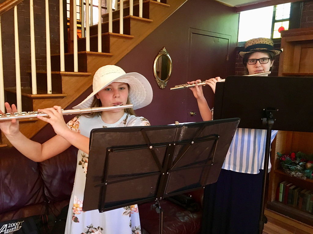 . Kayla Lavoie and Autumn Dwyer play their flutes at the Billerica Historical Society\'s Vintage Tea. They are members of Flutes, Inc. Photo by Mary Leach