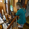 Maisie Douglas, 3, from Hudson, NH, peered down on the Billerica Historical Society's Vintage Tea fundraiser from the stairway at the Bennett Cultural Center. Photo by Mary Leach