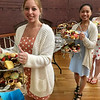 Leah Cahill, 15, Jocelyn Benitez, 15 and Nicole Young, 18, all of Billerica, served tasted treats at the Vintage Tea. Photo by Mary Leach