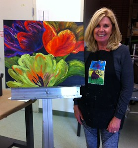 """Kim with another of her """"experimental"""" paintings"""
