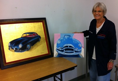 Anita with her oil painting of a Packard