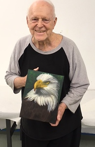 Gordon with his American Eagle painting, a gift to his grandson