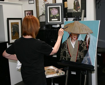 Barbara and her beautiful painting of an Asian lady.