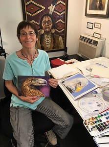 Joni with her two paintings of Eagles