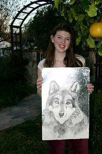 Sarah with her painting of a wolf.