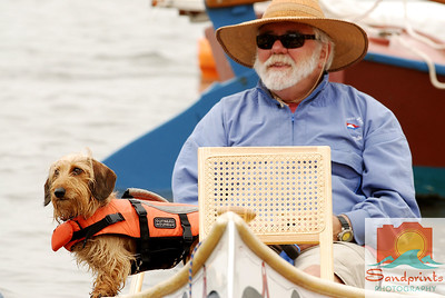 Soft-coated, wire-haired dachshund 'Cutter' enjoys the show from the water with his owner, Bob Kizziar.