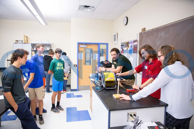 Scott Williams (green shirt) Grant Grieble (red shirt) and Catherine Fedor teaching at Geneseo High School