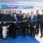 Cutting the ribbon for the new School of Business Trading Room were (l to r) student Jonathan Drabek, vice president of the Student Managed Investment Fund; alumnus Bob Murray '83; alumnus D ...