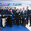 Cutting the ribbon for the new School of Business Trading Room were (l to r) student Jonathan Drabek, vice president of the Student Managed Investment Fund; alumnus Bob Murray '83; alumnus Dan Loughran '86; Denise Rotondo, dean of the School of Business; alumnus John Gleason '87; Geneseo President Denise A. Battles; alumni Kevin Gavagan '75, Michael Camarella '98 and Bob Walley '83; and student Nelson Scott, president of the Student Managed Investment Fund.