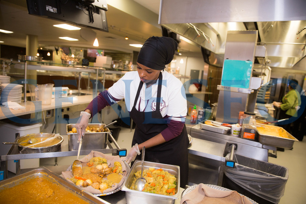 Chef Habiba Boru serves up spicy ethiopan cuisine at the 3rd Credo Kitchen Event