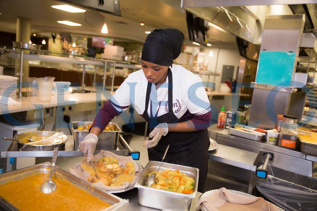 Chef Habiba Boru serves up spicy ethiopan cuisine at the 3rd Credo Kitchen Event
