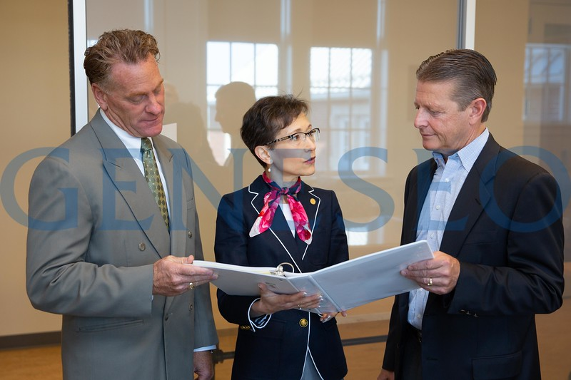 Left to right: Paul Morrell, Director of small business development center, President Denise A. Battles, and Senator Patrick Gallivan speak before the start of a small business development seminar in Doty Tower Room. Photo by Keith Walters