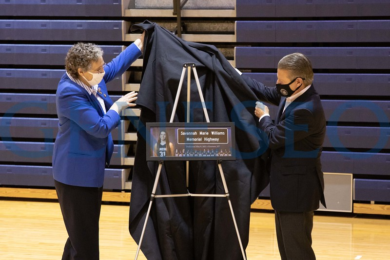 Assemblywoman Marjorie Byrnes and New York State Senator Patrick Gallivan reveal a tribute sign to Savannah Williams at a memorial event.