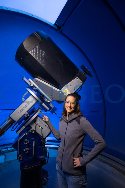 Ann Pellerin physics and astronomy portrait at telescope Fall 2017 KW