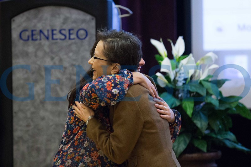 President Denise Battles surprises Sophia Garber '17 with her diploma after she delivered the all college hour lecture on her experiences riding from coast to coast on a bicycle