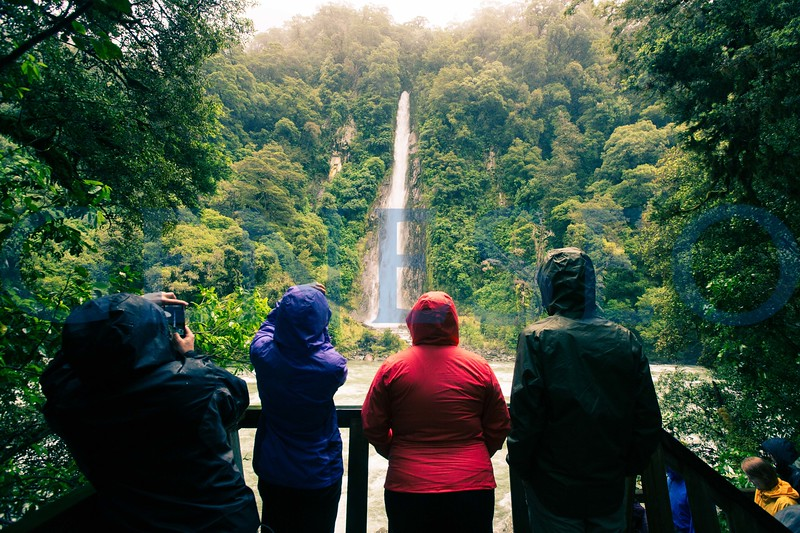 Students stop to see Thunder Creek Falls on the South Island