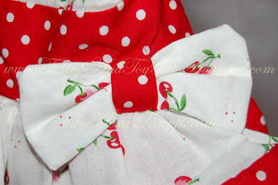ITEM NAME: Cherry Red Sassy Dress SHORT DISCRIPTION: Cherry Print, Red Poka Dot with Ruffles PRICE: $35.99 COLOR: Red and White