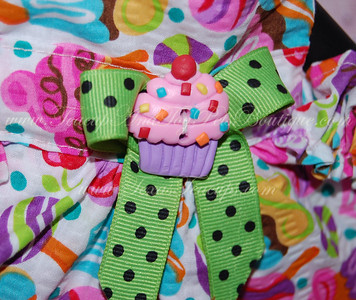 ITEM NAME: Cupcake Candy SHORT DISCRIPTION: Colorful Candy Designed Dress with Green Poka Bow and Pink Cupcake with Ruffles PRICE: $35.00 COLOR: Multicolored