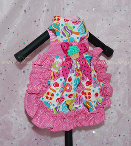 ITEM NAME: Pink Candy Cupcake SHORT DISCRIPTION: Colorful Candy Designed Dress with Hot Pink Poka Bow and Turquoise Cupcake with Ruffles PRICE: $35.00 COLOR: Multicolored