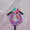 ITEM NAME: Purple Flower<br /> SHORT DISCRIPTION: Multicolred Flower Design with Purple Ruffles and Red Flower Accent<br /> PRICE: $35.00<br /> COLOR: Multicolored