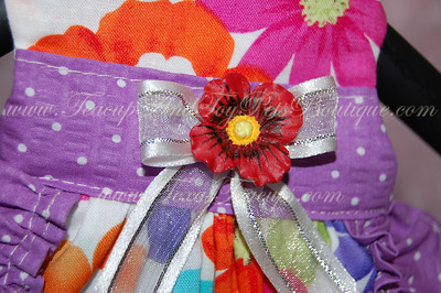 ITEM NAME: Purple Flower SHORT DISCRIPTION: Multicolred Flower Design with Purple Ruffles and Red Flower Accent PRICE: $35.00 COLOR: Multicolored