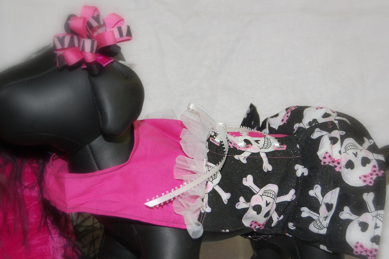 ITEM NAME: HOT PINK BIKER DRESS<br /> SKU: DDPNKSK<br /> DISCRIPTION: Hot pink dress with girly skulls on the ruffles. Has white lace up coming up the back.<br /> ALSO AVAILABLE IN RED (SKU: DDRDSK)<br /> <br /> PRICE: $32.00 - $34.00<br /> COLOR: Hot Pink/Black/White<br /> AVAILABLE SIZES:<br /> XX Small / X Small / Small<br /> <br /> ===========<br /> XX-Small<br /> Length: 7.5''<br /> Waist: 8''<br /> Price: $34<br /> ===========<br /> X-Small<br /> Length: 7.5''<br /> Waist: 10.5''<br /> Price: $34<br /> ===========<br /> Small<br /> Length: 9''<br /> Waist: 12.5''<br /> Price: $32<br /> ===========