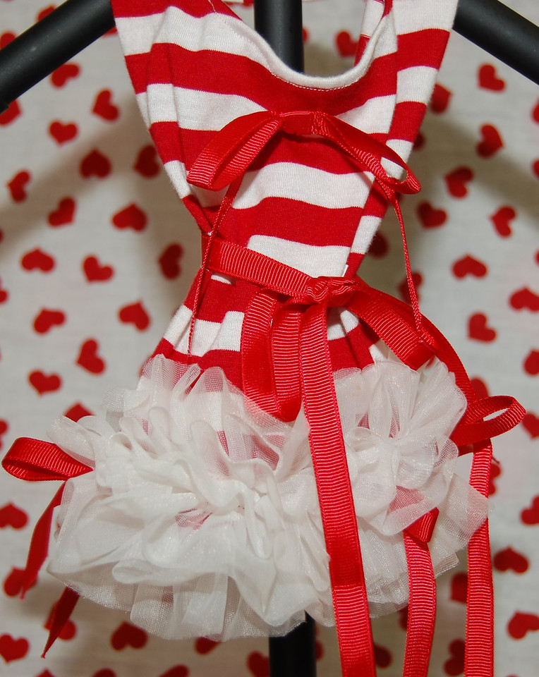 ITEM NAME: Red Stripe Dress with Ruffles<br /> SKU: DDRDSTRP<br /> DISCRIPTION: Red and White Striped Dress with White Lace and Red Ribbon<br />  <br /> PRICE: $25<br /> COLOR: Red<br /> AVAILABLE SIZES: XSmall<br /> ===========<br /> X-Small<br /> Length: 7.<br /> Waist: 8''<br /> Price: $25.00