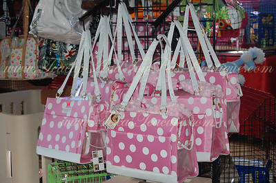 Fashionable pink pet carriers.